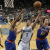 Orlando Magic\'s J.J. Redick (7) goes up for a shot between New York Knicks\' Steve Novak (16) and Rasheed Wallace, left, during the first half of an NBA basketball game, Tuesday, Nov. 13, 2012, in Orlando, Fla. (AP Photo/John Raoux)