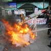 South Korean protesters burn a mock rocket as police officers spray fire extinguishers during a rally denouncing North Korea\'s rocket launch in Seoul, South Korea, Wednesday, Dec. 12, 2012. North Korea successfully fired a long-range rocket on Wednesday, defying international warnings as the regime of Kim Jong Un took a giant step forward in its quest to develop the technology to deliver a nuclear warhead. (AP Photo/Ahn Young-joon) ORG XMIT: SEL106