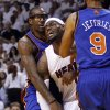 Photo -   Miami Heat's LeBron James, right, is fouled by New York Knicks' Amare Stoudemire, left, in the first half of an NBA basketball game in the first round of the Eastern Conference playoffs in Miami, Saturday, April 28, 2012. (AP Photo/Lynne Sladky)