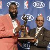 Oklahoma City Thunder's James Harden, left, receives the NBA\'s Sixth Man of the Year award from Kia\'s Percy Vaughn, right, during a basketball news conference in Oklahoma City, Thursday, May 10, 2012. Harden led all bench players in scoring this season by averaging 16.8 points on a career-best 49 percent. (AP Photo/Sue Ogrocki)