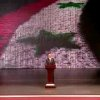 Photo - In this image taken from video obtained from Syrian State Television, which has been authenticated based on its contents and other AP reporting, Syrian President Bashar Assad speaks at the Opera House in central Damascus, Syria, Sunday, Jan. 6, 2013. Syrian President Bashar Assad on Sunday outlined a new peace initiative that includes a national reconciliation conference and a new government and constitution but demanded regional and Western countries stop funding and arming rebels first. (AP Photo/Syrian State Television via AP video)