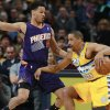 Photo - Denver Nuggets guard Andre Miller, right, works the ball inside as Phoenix Suns guard Gerald Green covers in the first quarter of an NBA basketball game in Denver on Friday, Dec. 20, 2013. (AP Photo/David Zalubowski)