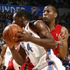 Oklahoma City\'s Desmond Mason drives past Joey Graham of Toronto in the first half during the NBA basketball game between the Toronto Raptors and the Oklahoma City Thunder at the Ford Center in Oklahoma City, Friday, Dec. 19, 2008. BY NATE BILLINGS, THE OKLAHOMAN