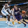 Photo - Phoenix Suns guard Goran Dragic, of Slovenia, drives the lane for a shot as Denver Nuggets center J.J. Hickson, left, and guard Randy Foye defend during the first quarter of an NBA basketball game in Denver on Tuesday, Feb. 18, 2014. (AP Photo/David Zalubowski)