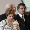 Brazil\'s President Dilma Rousseff, front, stands a minute of silence for the victims of a deadly fire at a nightclub during a meeting with mayors who recently took office in Brasilia, Brazil, Monday, Jan. 28, 2013. A blaze raced through a crowded nightclub in southern Brazil early Sunday, killing more than 230 people as the air filled with deadly smoke and panicked party-goers stampeded toward the exits, police and witnesses said. (AP Photo/Eraldo Peres) ORG XMIT: BSB111