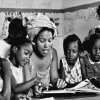 Photo - This 1966 photo provided by Maria Varela shows a member of the Student Nonviolent Coordinating Committee, SNCC, working with students in a Head Start program in Canton, Miss. The photo was taken by Varela, then a member of SNCC, and was one of the few Latinos involved in the black civil rights movement. (AP Photo/Maria Varela, File)