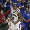 Kansas guard Sherron Collins (4) celebrates a three-point basket during the second half of their college basketball game against Missouri in Lawrence, Kan., Monday, Jan. 15, 2007. Collins scored 23 points to lead Kansas to an 80-77 win over Missouri. (AP Photo/Orlin Wagner) ORG XMIT: KSOW105