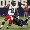 Florida International\'s Darrian Dyson, right, pursues Arkansas State quarterback Ryan Alpin in the first quarter of an NCAA college football game at FIU Stadium in Miami, Thursday, Oct. 4, 2012. (AP Photo/The Miami Herald, Charles Trainor Jr.) MAGAZINES OUT