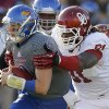 OU\'s Charles Tapper (91) brings down KU\'s Jake Heaps (9) during the college football game between the University of Oklahoma Sooners (OU) and the University of Kansas Jayhawks (KU) at Memorial Stadium in Lawrence, Kan., Saturday, Oct. 19, 2013. Oklahoma won 34-19. Photo by Bryan Terry, The Oklahoman