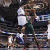 Dallas Mavericks\' Elton Brand (42) stops a shot attempt by Milwaukee Bucks\' John Henson (31) in the first half of an NBA basketball game Tuesday, Feb. 26, 2013, in Dallas. Bucks\' Ekpe Udoh (13) and Mavericks\' Dirk Nowitzki (41) watch. (AP Photo/Tony Gutierrez)