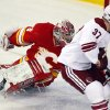 Phoenix Coyotes\' Raffi Torres, right, scores on Calgary Flames goalie Joey MacDonald during the second period of an NHL hockey game in Calgary, Alberta, Sunday, Feb. 24, 2013. (AP Photo/The Canadian Press, Jeff McIntosh)