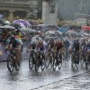 Photo -   Cyclists pedal under pouring rain during the Women's Road Cycling race at the 2012 Summer Olympics, Sunday, July 29, 2012, in London. (AP Photo/Matt Rourke)