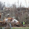 People inspect the damage at homes in Henryville, Ind.,after powerful storms stretching from the U.S. Gulf Coast to the Great Lakes in the north wrecked two small towns and killed at least eight people Friday, March 2, 2012, as the system tore roofs off schools and homes and damaged a maximum security prison. It was the second deadly tornado outbreak this week. (AP Photo/The News and Tribune, C.E. Branham) ORG XMIT: INJEF103