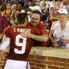 Oklahoma\'s Trevor Knight (9) gets hugs from family following the college football game where the University of Oklahoma Sooners (OU) play the University of Louisiana Monroe Warhawks at Gaylord Family-Oklahoma Memorial Stadium in Norman, Okla., on Saturday, Aug. 31, 2013. Photo by Steve Sisney, The Oklahoman