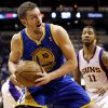 Golden State Warriors\' David Lee (10) drives against Phoenix Suns\' Markieff Morris (11) during the first half of an NBA basketball game on Friday, April 5, 2013, in Phoenix. (AP Photo/Matt York)