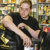 Sonny Qualm, senior at Oklahoma Centennial High School, bags groceries at Youth Services of Oklahoma County. Qualm attributes Youth Service\'s Supporting Kids in Independent Living (SKIL) program with keeping him focusing on graduation in May. Photo by Zeke Campfield, The Oklahoman