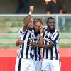 Photo - Juventus defender Martin Caceres, center, celebrates with teammates Arturo Vidal, left, and Kwadwo Asamoah after scoring his side's opening goal during a Serie A soccer match between Chievo Verona and Juventus at the Bentegodi stadium, in Verona, Italy, Saturday, Aug. 30, 2014. (AP Photo/Massimo Pinca)