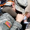 SPC Aubrey Lindley of Bixby, OK, kisses the leg of his 15-month-old son, Treyton, who sits on his dad\'s shoulders, after the 45th Infantry Brigade Combat Team Deployment Ceremony in downtown Oklahoma City, Wednesday, Feb. 16, 2011. This will be Lindley\'s first deployment. Photo by Jim Beckel, The Oklahoman