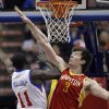 Philadelphia 76ers\' Jrue Holiday, left, goes up for a shot against Houston Rockets\' Omer Asik, of Turkey, in the first half of an NBA basketball game, Saturday, Jan. 12, 2013, in Philadelphia. (AP Photo/Matt Slocum)