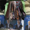 An Egyptian street vendor displays ties over posters of Presidential candidate Selim el-Awa for the upcoming elections in Cairo, Egypt, Thursday, April 26, 2012. Egypt\'s election commission announced the final list of candidates this week for next month\'s presidential elections. Arabic on the posters read,