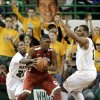 Baylor fans hold a large photo cut out of head coach Scott Drew, rear, as A.J. Walton, left, and Rico Gathers, right, defend against Oklahoma \'s Andrew Fitzgerald, center, during the second half of an NCAA college basketball game Wednesday, Jan. 30, 2013, in Waco, Texas. Oklahoma won 74-71. (AP Photo/Tony Gutierrez) ORG XMIT: TXTG113