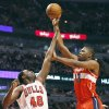 Photo - Washington Wizards center Kevin Seraphin, of France, right, shoots over Chicago Bulls center Nazr Mohammed during the first half of an NBA basketball game in Chicago on Saturday, Dec. 29, 2012. (AP Photo/Nam Y. Huh)