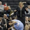 Photo - North Carolina's Allisha Gray, left, falls out of bounds as Wake Forest head coach Jen Hoover, top right, watches during the first half of an NCAA college basketball game in Winston-Salem, N.C., Thursday, Jan. 23, 2014. (AP Photo/Chuck Burton)