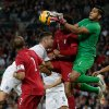 Photo - England's Gary Cahill, second left, competes for the ball with Peru's Alexander Callens, center, and goalkeeper Raul Fernandez, second right, during the international friendly soccer match between England and Peru at Wembley Stadium in London, Friday, May 30, 2014.  (AP Photo/Matt Dunham)