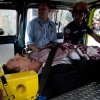 Photo - Software company founder John McAfee lies inside an ambulance, to be transferred from an immigration detention center to a hospital, in Guatemala City, Thursday, Dec. 6, 2012 . He was examined by a doctor at the detention center, who said that McAfee's heart and blood pressure were normal, but nonetheless was being moved to a hospital after McAfee was found lying on the floor in the room where he was being detained. McAfee who fled Belize was denied political asylum in Guatemala on Thursday and police in Belize said they expected him to be flown back soon for questioning about the killing of a fellow American expatriate. (AP Photo/Moises Castillo)