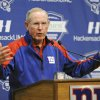 Photo - New York Giants coach Tom Coughlin speaks to the media Monday, Dec. 30, 2013, in East Rutherford, N.J. after the Giants season ended with a 7-9 record. (AP Photo/Bill Kostroun)