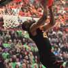 Oklahoma State guard Markel Brown performs a reverse slam dunk during Oklahoma State\'s Homecoming and Hoops event at Gallagher Iba Arena in Stillwater on October 18, 2013. Photo by KT King/For the Oklahoman