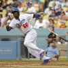 Photo - FILE - In this June 30, 2013 file photo, Los Angeles Dodgers' Yasiel Puig hits a triple against the Philadelphia Phillies during the fifth inning of a baseball game in Los Angeles. Much of the focus as baseball heads into the second half is being placed on the possible suspensions of Alex Rodriguez, Ryan Braun and a handful of All-Stars implicated in the Biogenesis performance-enhancing drug scandal. Puigmania, a Pirates revival and one impressive power show in Baltimore should shift the gaze right back onto the field. (AP Photo/Mark J. Terrill, File)