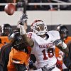 Oklahoma State\'s Daytawion Lowe (8) breaks up a pass for Oklahoma\'s Kameel Jackson (18) during the Bedlam college football game between the Oklahoma State University Cowboys (OSU) and the University of Oklahoma Sooners (OU) at Boone Pickens Stadium in Stillwater, Okla., Saturday, Dec. 3, 2011. Photo by Chris Landsberger, The Oklahoman