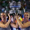 Photo - Italy's Sara Errani, right, and Roberta Vinci hold the championship trophy after defeating Russia's Ekaterina Makarova and Elena Vesnina in their women's doubles final at the Australian Open tennis championship in Melbourne, Australia, Friday, Jan. 24, 2014.(AP Photo/Aaron Favila)