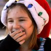 Hannah Alexander, 10, laughs and covers her mouth when marshmallow oozes out of it after she bit into a s\'mores snack. Alexander is a Junior Girl Scout in Troop 625. Edmond Girl Scouts made S\'mores, a popular winter snack, on a corner in downtown Edmond Saturday, Dec. 17, 2011, as a fundraiser for their troop. The Scouts, with Troop 625, used a griddle as their heat source to melt marshmallows on a skewer and sandwich it with a square of chocolate between two graham crackers. Money raised will help girls who want to join Scouts but require some financial assistance with the activity fees and various other costs involved in Scouting. This activity was part of a series of Downtown Edmond\' Christmas celebrations. Photo by Jim Beckel, The Oklahoman