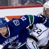 Vancouver Canucks\' Alexander Edler, left, of Sweden, and Los Angeles Kings\' Trevor Lewis collide during the second period of an NHL hockey game in Vancouver, British Columbia on Saturday, March 2, 2013. (AP Photo/The Canadian Press, Darryl Dyck)