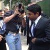 Photo - Journalists photograph Rengan Rajaratnam, right, as he exits Manhattan federal court in New York on Tuesday, July 8, 2014 after being acquitted of conspiracy to commit securities fraud. Prosecutors had alleged that Rajaratnam, 43, joined with his brother, Raj Rajaratnam, to cheat in the stock market in 2008 on the securities of two technology companies. (AP Photo/Larry Neumeister)