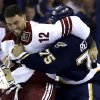 Photo - Phoenix Coyotes' Paul Bissonnette (12) and St. Louis Blues' Ryan Reaves fight during the first period of an NHL hockey game on Thursday, April 18, 2013, in St. Louis. (AP Photo/Jeff Roberson)