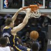 Indiana Pacers\' Tyler Hansbrough, top, dunks the ball against the Milwaukee Bucks during the first half of an NBA basketball game on Wednesday, Nov. 14, 2012, in Milwaukee. (AP Photo/Tom Lynn)