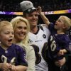 Photo - Bill Bajema was part of the 2012 Baltimore Ravens team that won Super Bowl XLVII on Feb. 3, 2013, in the Mercedes-Benz Superdome in New Orleans. Bajema is shown with wife, Emily, and sons Will, left, and Ben, right. The Bajema family lives in Edmond.