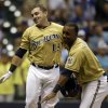 Milwaukee Brewers\' Caleb Gindl, left, celebrates with teammate Jean Segura after hitting a walkoff home run during the 13th inning of a baseball game against the Miami Marlins, Sunday, July 21, 2013, in Milwaukee. (AP Photo/Morry Gash)