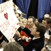 John Edwards autographs a sign for supporters during a campaign stop at the Teamster Local on Friday, January 18, 2008, in Oklahoma City, Okla. BY SARAH PHIPPS, THE OKLAHOMAN