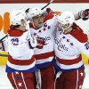 Washington Capitals\' Alex Ovechkin (8), John Carlson (74) and Troy Brouwer (20) celebrate Ovechkin\'s goal against the Winnipeg Jets during the third period of an NHL hockey game in Winnipeg, Manitoba, on Thursday, March 21, 2013. The Capitals won 4-0. (AP Photo/The Canadian Press, John Woods)