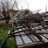 Bystanders look over what remains of an Evergreen Lawncare warehouse off East Fourth Street in Owensboro, Ky., Friday, March 2, 2012. Powerful storms stretching from the U.S. Gulf Coast to the Great Lakes in the north wrecked two small towns, killed at least three people and bred anxiety across a wide swath of the country on Friday, in the second deadly tornado outbreak this week. (AP Photo/The Messenger-Inquirer, Gary Emord-Netzley) ORG XMIT: KYOWE101