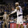 Dallas Mavericks\' Vince Carter (25) celebrates after sinking a 3-point basket against the Orlando Magic in the second half of an NBA basketball game Wednesday, Feb. 20, 2013, in Dallas. The Mavericks won 111-96. (AP Photo/Tony Gutierrez)