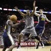 San Antonio Spurs\' Tim Duncan (21) loses control of the ball as he is defended by Utah Jazz\' Paul Millsap, left, and Gordon Hayward (20) during the fourth quarter of an NBA basketball game, Saturday, Nov. 3, 2012, in San Antonio. (AP Photo/Eric Gay)