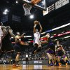 Oklahoma City Thunder\'s Thabo Sefolosha (2), of Switzerland, shoots as he gets past Phoenix Suns\' Luis Scola, third from left, of Argentina, and Marcin Gortat, third from right, of Poland, while Thunder\'s Kendrick Perkins (5) and Kevin Durant (35) watch along with Suns\' Goran Dragic (1), of Slovenia, during the first half in an NBA basketball game, Sunday, Feb. 10, 2013, in Phoenix. (AP Photo/Ross D. Franklin) ORG XMIT: PNU108