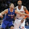 Photo - New York Knicks' Carmelo Anthony, right, and Los Angeles Clippers' Blake Griffin (32) fight for position during the first half of an NBA basketball game, Friday, Jan. 17, 2014, in New York. (AP Photo/Frank Franklin II)