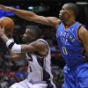 Photo - New Jersey Nets guard Keyon Dooling, left, looks to shoot the ball as Oklahoma City Thunder guard Russell Westbrook defends during the second quarter of an NBA basketball game Monday night, Jan. 12, 2009 in East Rutherford, N.J. (AP Photo/Bill Kostroun) ORG XMIT: ERA103