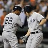 Photo -   New York Yankees' Steve Pearce, right, celebrates his two-run home run against the Baltimore Orioles with Andruw Jones, who scored on the play, in the fourth inning of a baseball game Friday, Sept. 7, 2012, in Baltimore. (AP Photo/Gail Burton)